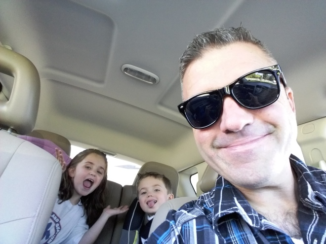 Keith driving with kids selfie