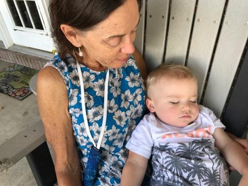 Tucker sleeping on Grandma Val
